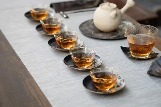 Glass tea cups on ceramic saucers, such as one would see when exploring tea in Hong Kong