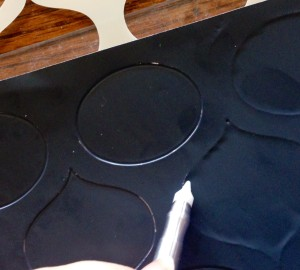 Rub against the stencil with a paper stump and outline with Teflon tip
