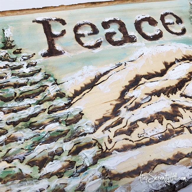 Create a holiday sign using wood burning techniques with stencils from The Crafter's Workshop as the design guide • AtopSerenityHil.com #woodburning #stencils #holidaydecor