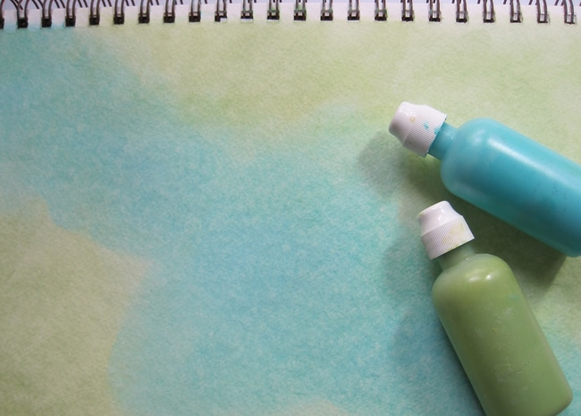Blend acrylic paints with baby wipes to begin background of journal page