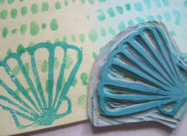 Hand carved stamps in an ocean theme add interest to the journal page.