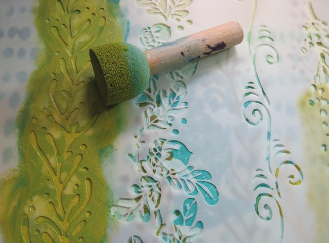 Citron acrylic paint and fanciful borders stencil creates a seaweed jungle.