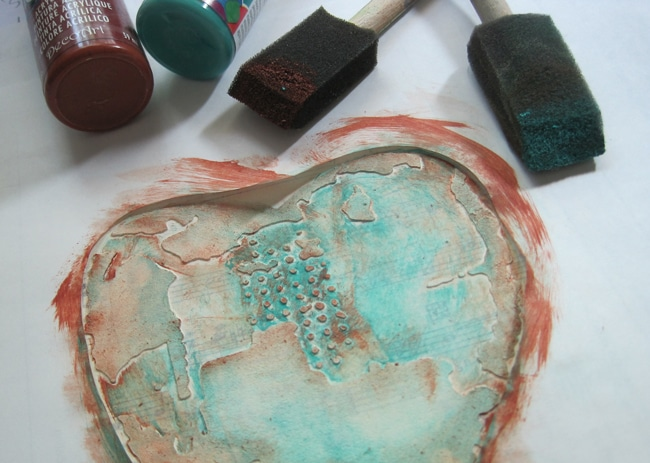 Add acrylic paint to exposed stenciled heart LEFKO