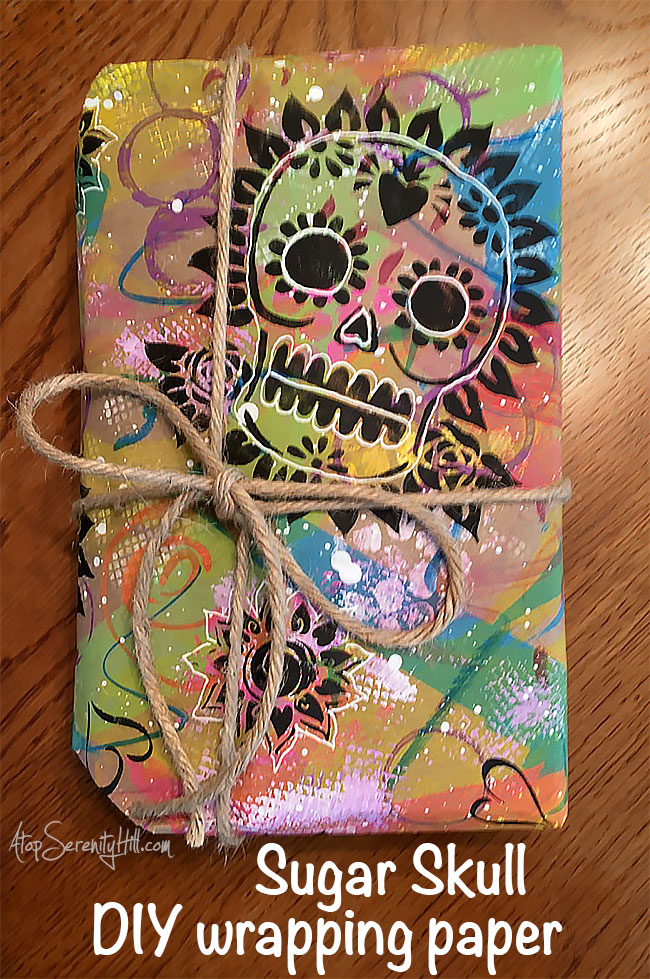 Sugar skull DIY wrapping paper using stencils from The Crafter's Workshop • AtopSerenityHill.com #stencil #wrappingpaper #sugarskull
