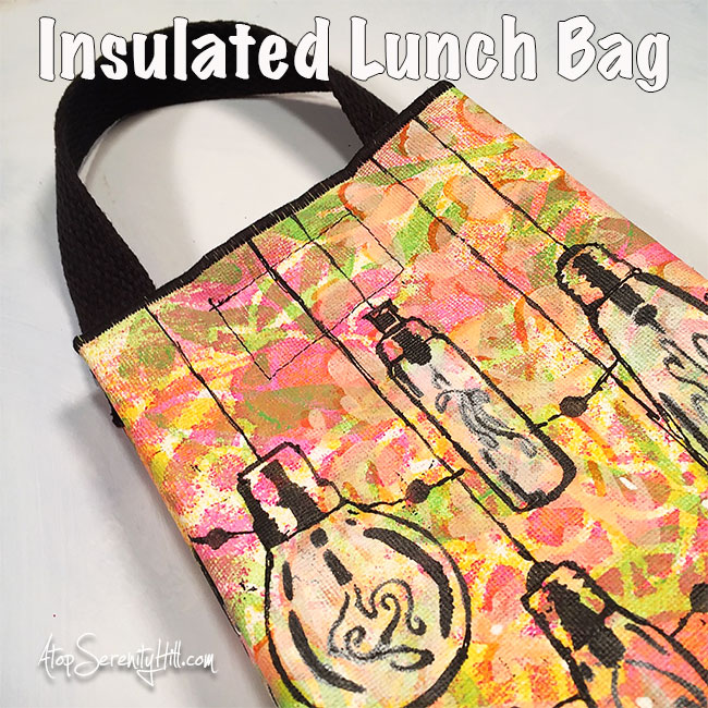 An insulated lunch bag created using stencils from The Crafter's Workshop • AtopSerenityHill.com
