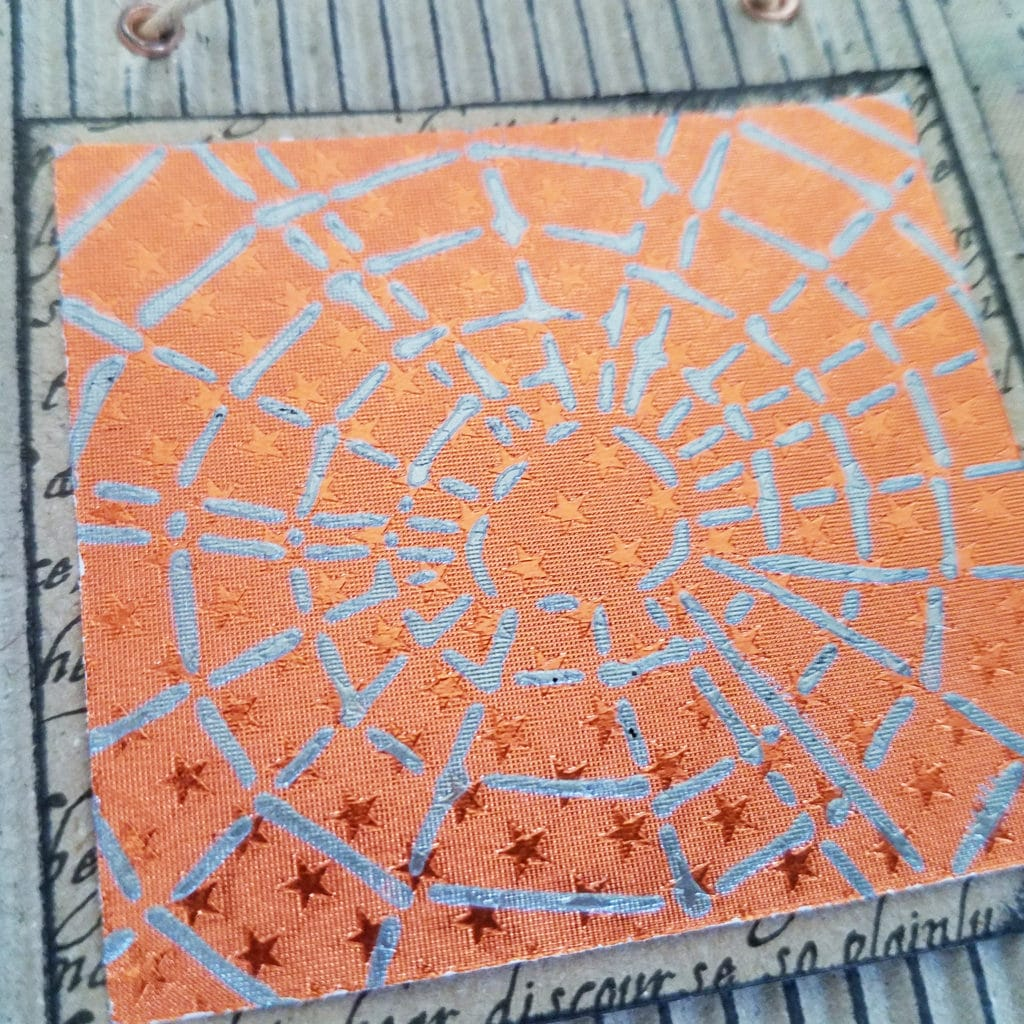 halloween banner using rinea foiled paper and modeling paste