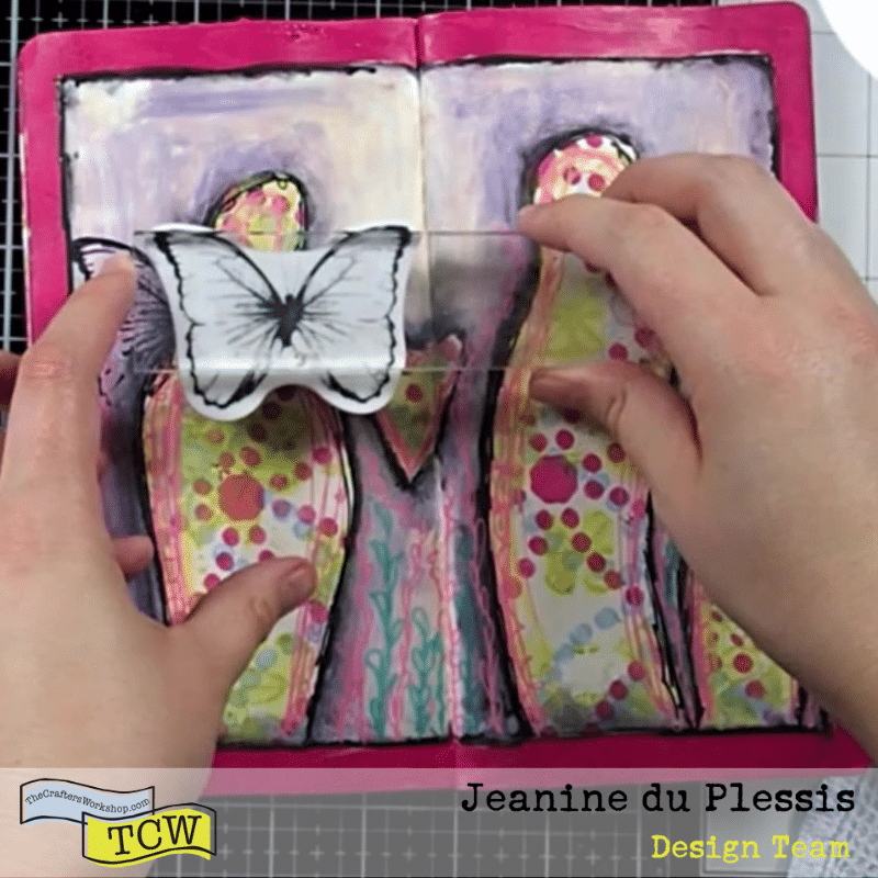 Butterfly wings being stamped around the figures to create wings. #stamping #butterfly #wings #figures