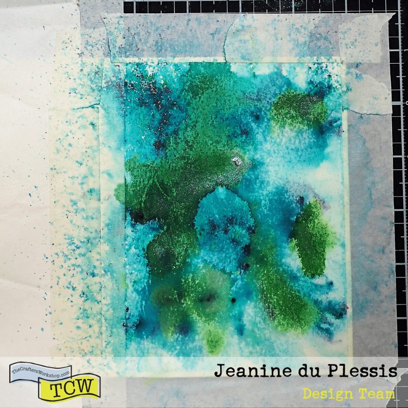 picture of a card taped down with masking tape.  Blue and green splotches of color that appear textured and has some shimmer to it. #kenoliver #watercolors
