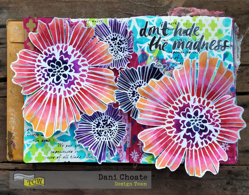 finished art journal page with flowers