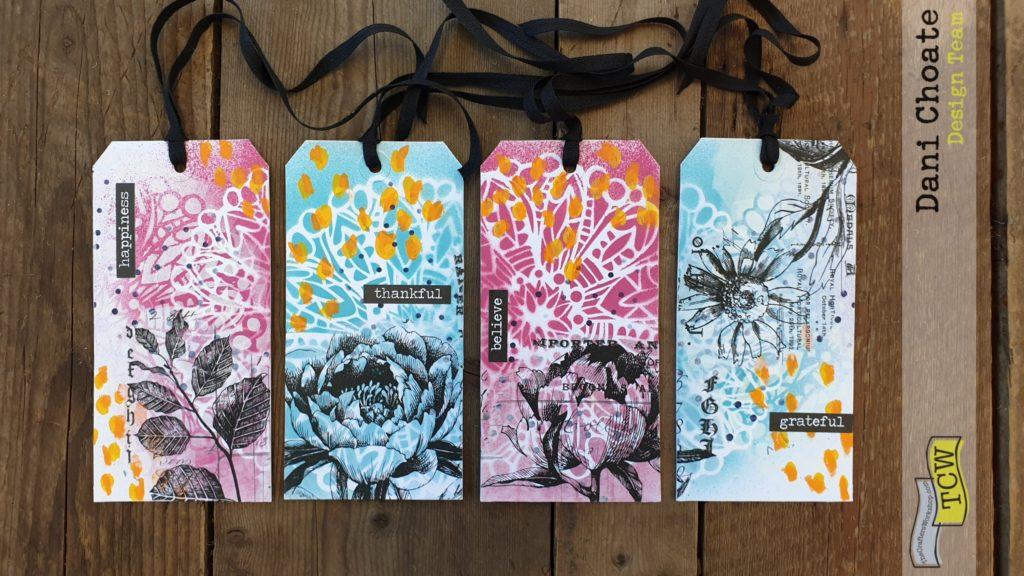Group of 4 stencilled tags in blue and pink