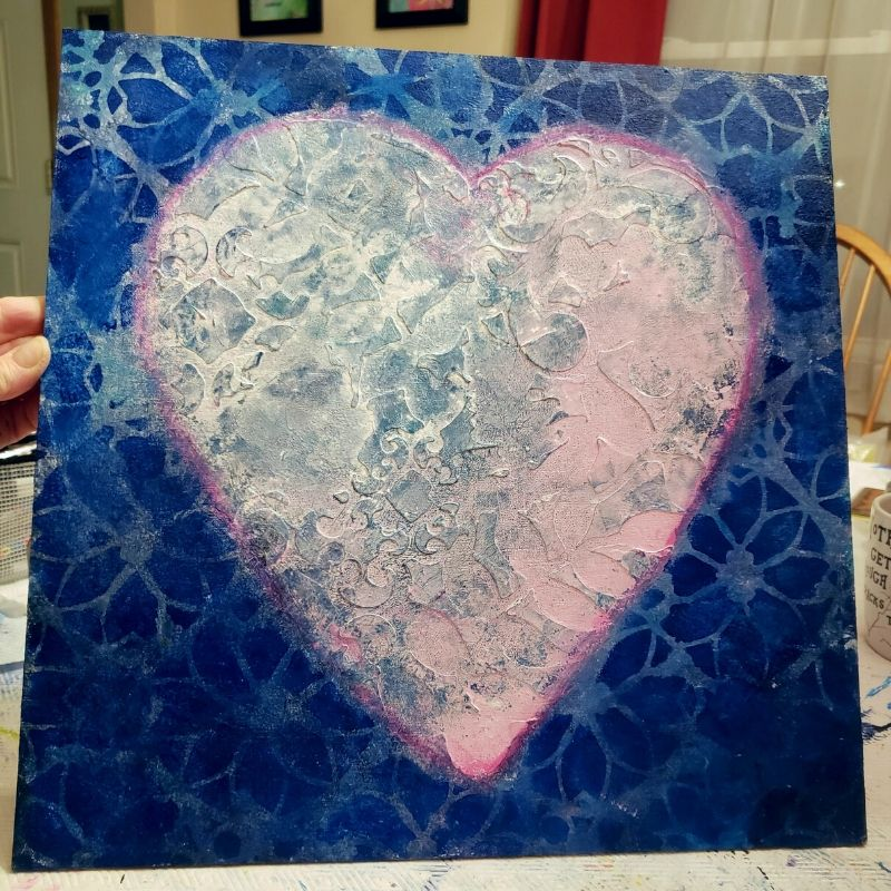 I added TCW803 Distressed Lace stencil around the heart.