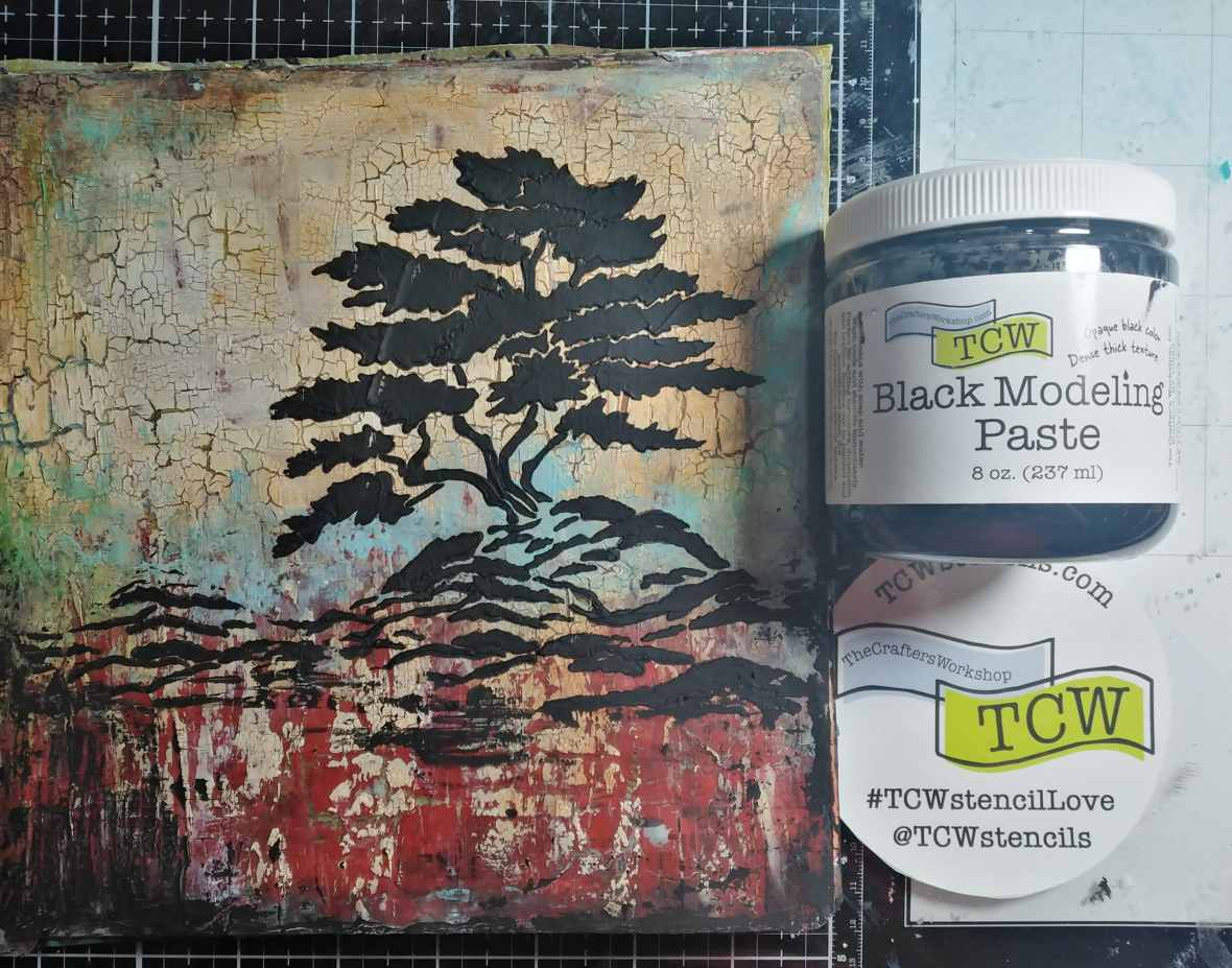 Application of the Crafter's Workshop black modeling paste through a TCW 866 Cypress Tree stencil.