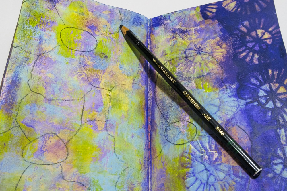 Sketch in flower shapes using black Stabilo pencil