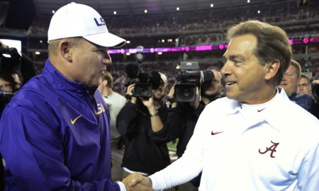 nick saban and les miles shaking hands