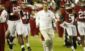 Nick Saban running on the field