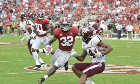 Dylan Moses gets ready to tackle a Texas A&M player