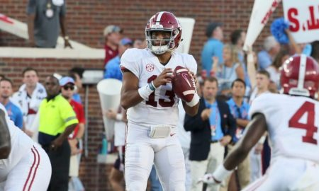 Tua standing with the football