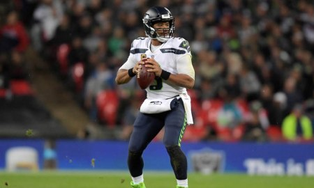 Russel Wilson throwing a pass in London