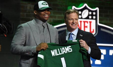 Quinnen Wiliams holding jersey with Roger Goodell