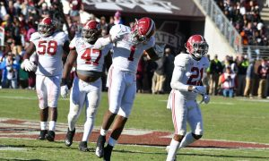 Ben Davis celebrates a sack versus Mississippi State in 2019