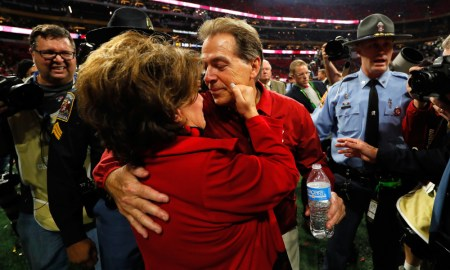 Terry Saban pinches Nick Saban's cheek after 2018 SEC Championship Game
