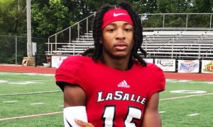 Devonta Smith posing for picture in La Salle uniform