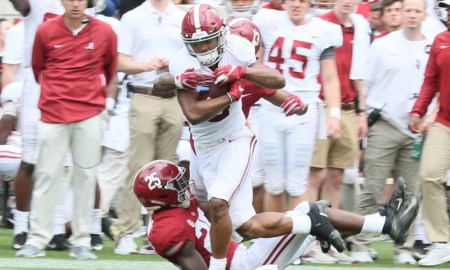 john metchie breaks a tackle during A-Day game