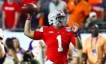 Justin Fields of Ohio State attempting a pass during 2019 CFP semifinal matchup (Fiesta Bowl) versus Clemson
