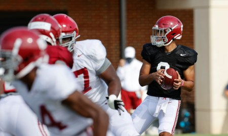 Bryce Young attempting to throw a pass at Alabama fall practice