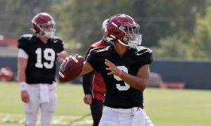 Bryce Young attempts a pass in 2020 fall camp for Alabama