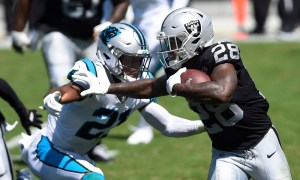 Josh Jacobs of the Raiders runs the ball versus Carolina Panthers