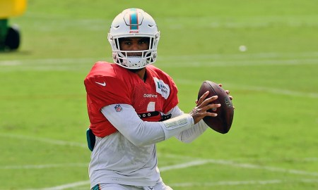 Tua Tagovailoa about to throw a pass at Dolphins training camp