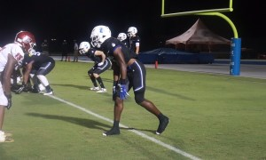Jacorey Brooks gets in wide receiver stance