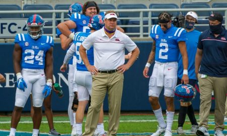 Lane Kiffin watches team from the sideline