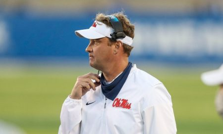 Lane Kiffin watches a play during Ole Miss game against Kentucky