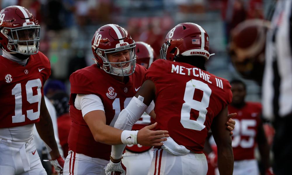 Mac Jones and John Metchie celebrate a touchdown for Alabama versus Texas A&M