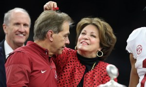 Nick Saban wife Terry Saban removes confetti from his hair