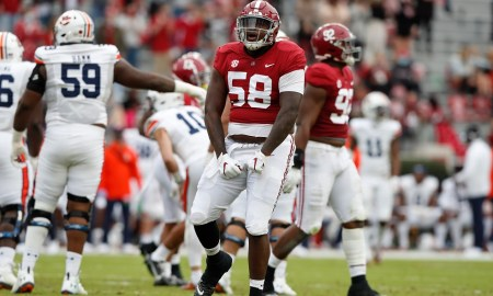 Alabama DT Christian Barmore flexes muscles during Iron bowl win over auburn