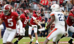 Mac Jones throwing the football