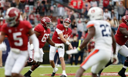 Mac Jones throws the football for Alabama as the Tide defeat Auburn in the 85th Iron Bowl