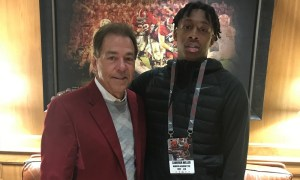 Cameron Miller poses for Picture with Nick Saban during visit