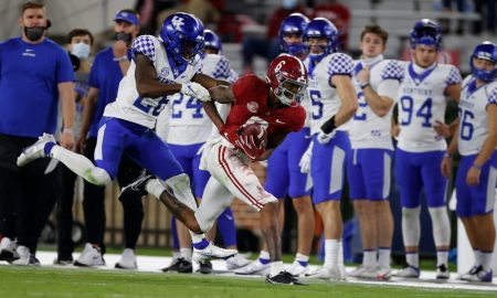 DeVonta Smith catches a pass on the sidelines against Kentucky