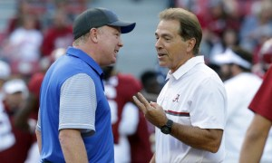 Nick Saban and Mark Stoops talking to each other before Alabama-Kentucky game in 2016