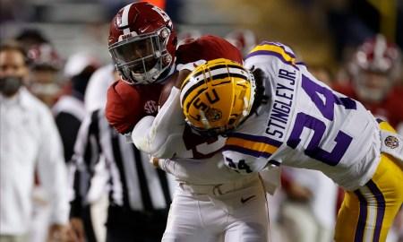 Alabama TE Jahleel Billigsley carries the football against LSU
