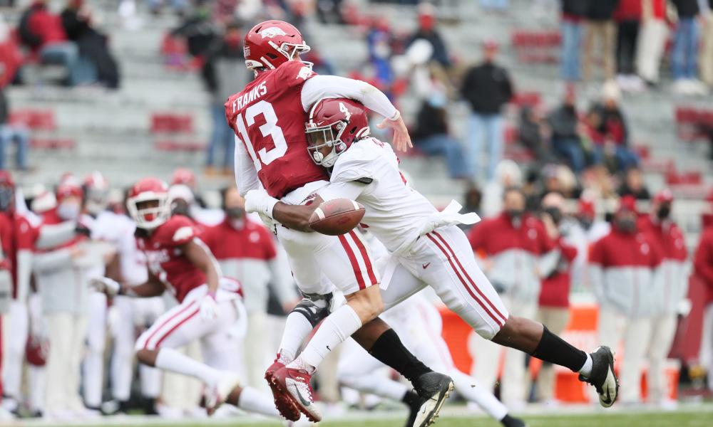 Christopher Allen (No. 4) of Alabama sacks Feleipe Franks of Arkansas