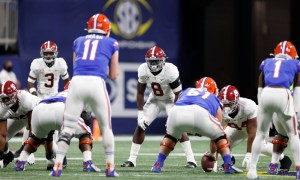 Christian Harris (No. 8) in his stance at ILB for Alabama in SEC title game