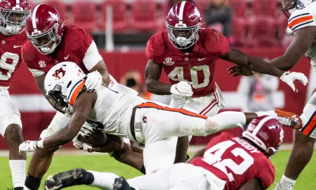 Christopher Allen (No. 4) of Alabama makes a stop on Auburn RB
