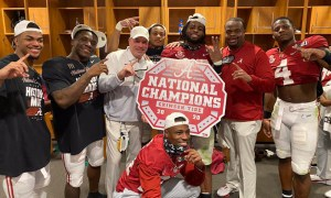 Charles Huff (in red shirt) celebrates CFP title with Alabama
