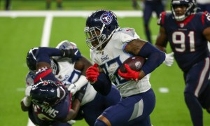 Derrick Henry, RB of Tennessee Titans, runs the ball against Houston Texas