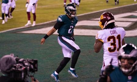 Jalen Hurts celebrates a touchdown for Eagles versus Washington